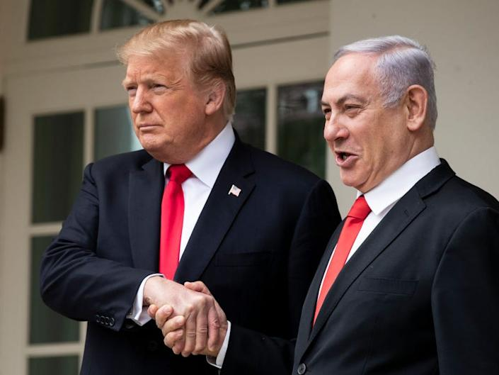President Donald Trump and Prime Minister of Israel Benjamin Netanyahu shake hands while walking through the colonnade prior to an Oval Office meeting at the White House March 25, 2019 in Washington, DC.