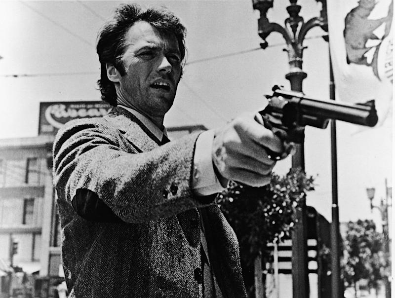 "American actor Clint Eastwood points his pistol in a still from the film ""Dirty Harry""."