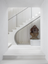 <p>Architect Bobby McAlpine's Atlanta home is full of artistic intrigue, clean lines, and a monochromatic palette. His entry features a bright and airy stairwell painted white to make the adjacent rooms and pleated curtains, giving the space an ethereal feel.</p>