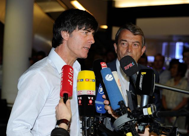 FRANKFURT AM MAIN, GERMANY - JUNE 29: Head coach Joachim Loew of German National Football team (DFB) talks to media during the German National Team arrival at Franfurt Airport on June 29, 2012 in Frankfurt am Main, Germany. Germany lost the UEFA EURO 2012 semi-final match against Italy in Poland last night. (Photo by Thorsten Wagner/Bongarts/Getty Images)