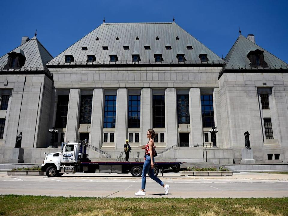 The Supreme Court of Canada signalled it will hear the appeal of a former Canadian soldier who was convicted by court martial in the military justice system of sexual assault and voyeurism. (Justin Tang/The Canadian Press - image credit)