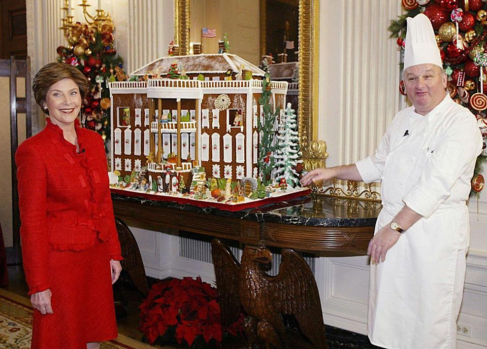 <p>Chef Roland Mesnier created the first White House in gingerbread. He shows off one of his creations here with Laura Bush. </p>