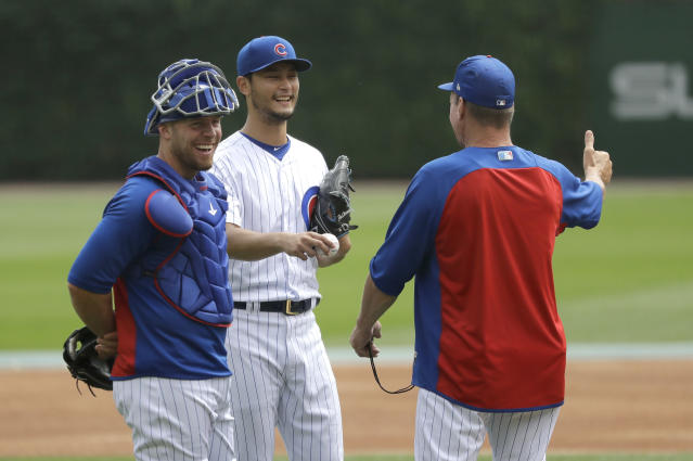 Chicago Cubs starting pitcher Yu Darvish, center, and back up catcher Chris Gimenez, left, laugh with pitching coach Jim Hickey during Darvish's simulated game before a baseball game between the Cubs and the Los Angeles Dodgers Wednesday, June 20, 2018, in Chicago. (AP Photo/Charles Rex Arbogast)