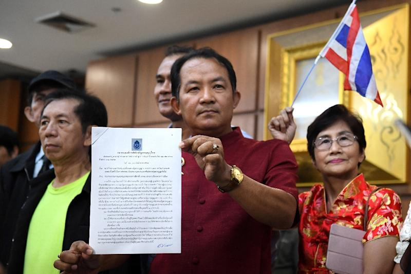 Srisuwan Janya from a royalist activist group called on the Thai Raksa Chart leader to resign (AFP Photo/Lillian SUWANRUMPHA                )