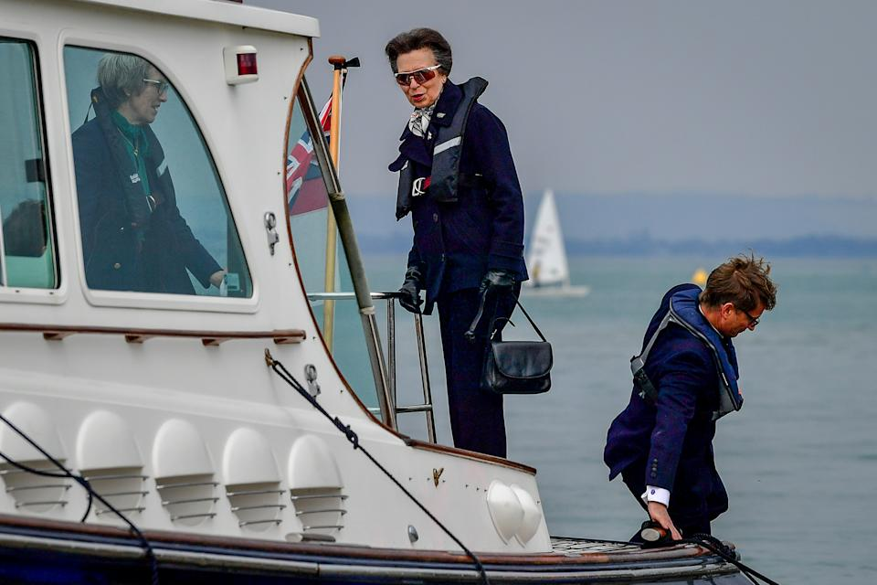 The Princess Royal arrives by boat to the Royal Victoria Yacht Club, on the Isle of Wight. Picture date: Wednesday April 14, 2021.