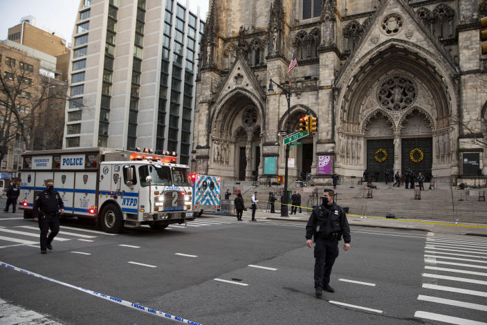 New York police officers block off the scene of a shooting at the Cathedral Church of St. John the Divine, Sunday, Dec. 13, 2020, in New York. A man was shot by police after shots rang out at the end of a Christmas choral concert on the steps of the Manhattan cathedral Sunday afternoon. It's unclear if the gunman was killed or if any others were injured. The shooting happened just before 4 p.m. at the church which is the mother church of the Episcopal Diocese of New York and seat of its bishop. (AP Photo/Ted Shaffrey)