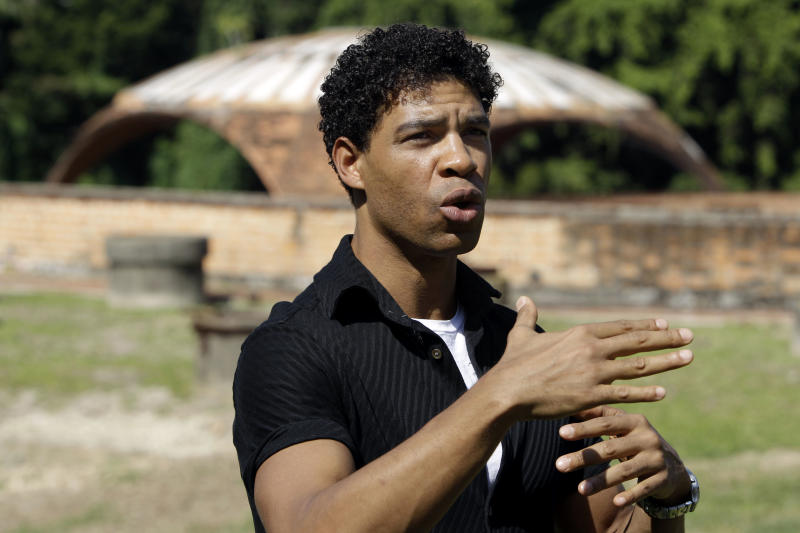 Celebrity ballet dancer Carlos Acosta speaks to journalists at the site of an old and abandoned dance school in Havana, Cuba, Friday, Nov. 2, 2012. Acosta, a 39-year-old ballet star from Cuba, pledges to raise millions of dollars to rescue the ruins of the architectural masterpiece that was abandoned in mid-construction five decades ago and turn it into an international center for culture and dance. (AP Photo/Franklin Reyes)