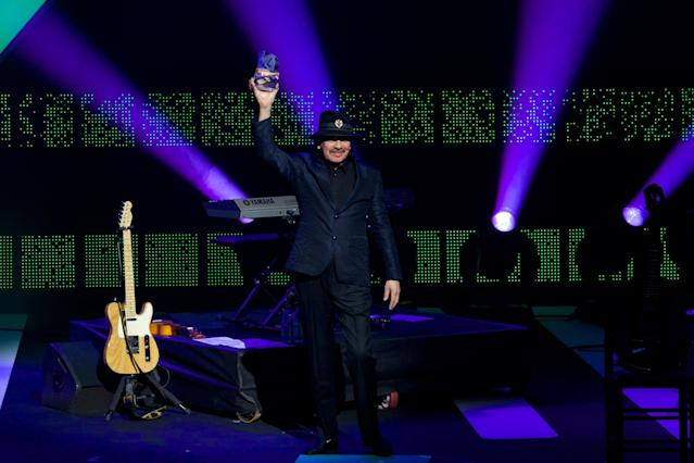 VALLADOLID, SPAIN - MARCH 07: Carlos Santana receives the Cadena Dial award during the Cadena Dial 2013 awards ceremony at the Miguel Delibes auditorium on March 7, 2014 in Valladolid, Spain. (Photo by Carlos Alvarez/Getty Images)