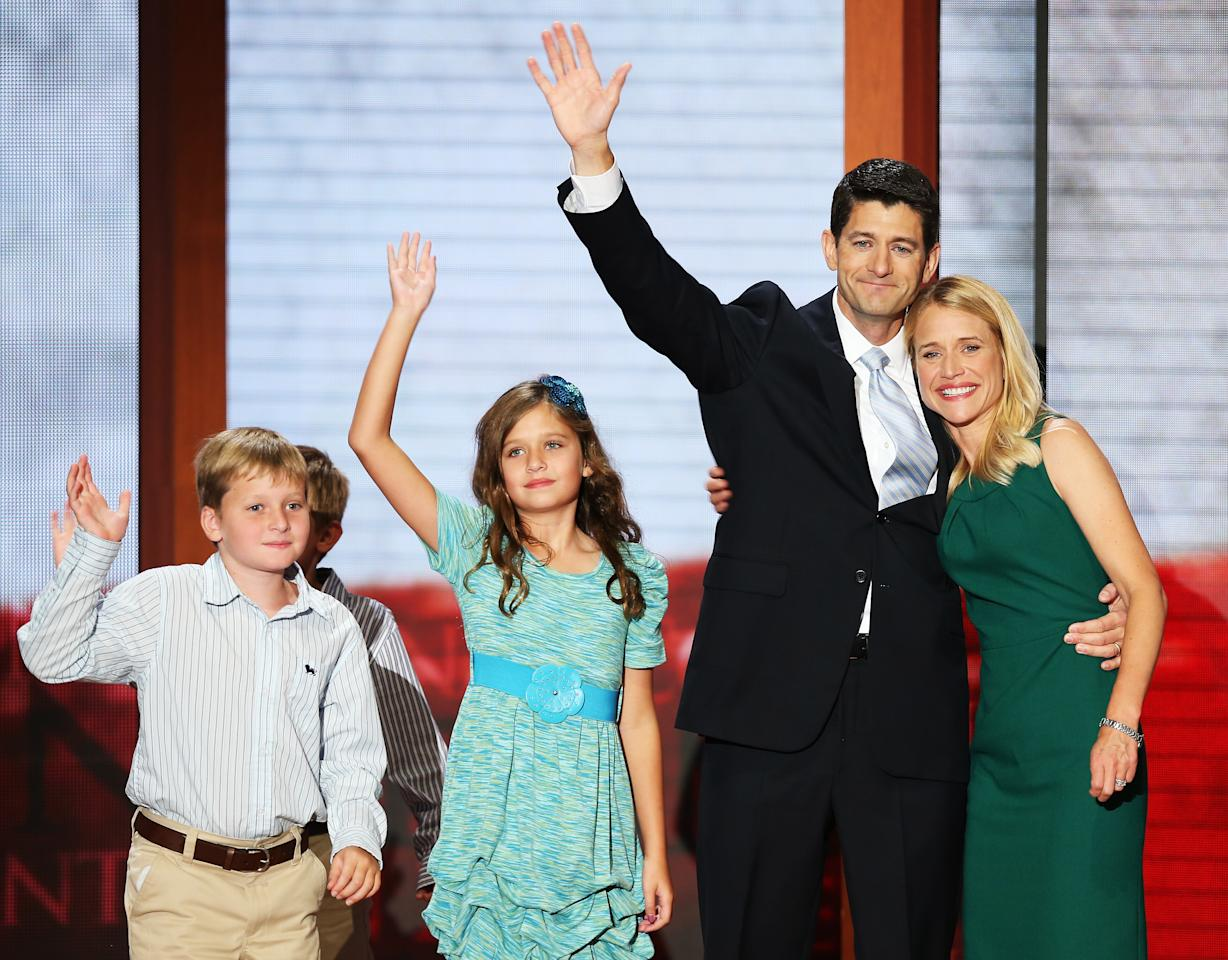 Republican vice presidential candidate, U.S. Rep. Paul Ryan (R-WI) waves with his family, daughter, Liza Ryan, sons, Charlie Ryan (L) and Sam Ryan and wife, Janna Ryan during the third day of the Republican National Convention at the Tampa Bay Times Forum on August 29, 2012 in Tampa, Florida. Former Massachusetts Gov. Mitt Romney was nominated as the Republican presidential candidate during the RNC, which is scheduled to conclude August 30.  (Photo by Mark Wilson/Getty Images)