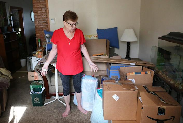 Dover resident Mary Cameron is seen packing her things  Tuesday, Sept. 14, 2021, in her apartment, but she has been unable to find a new home that will accept her Housing Choice Voucher as payment.