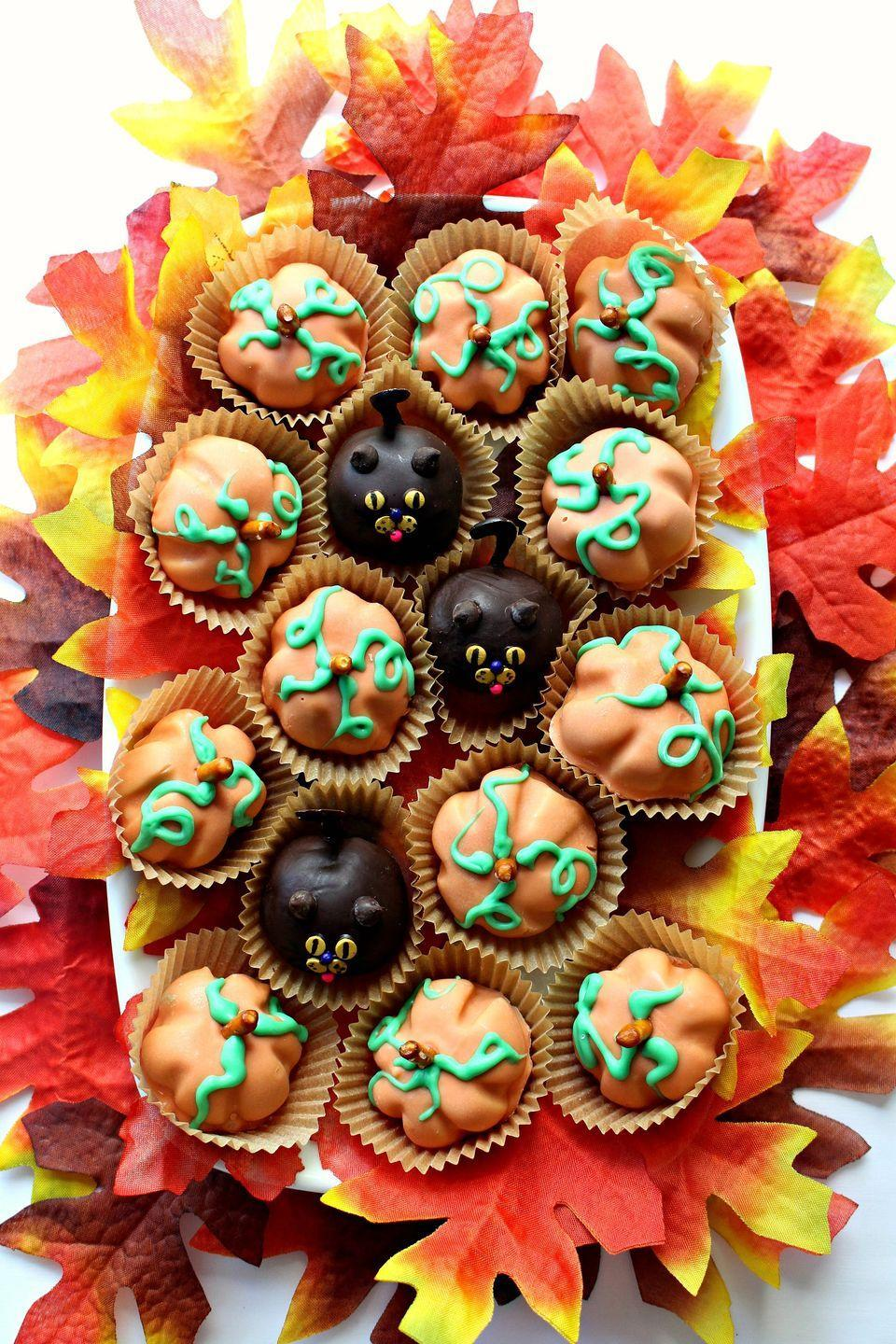 """<p>How adorable are these? Plus, no one can resist peanut butter and chocolate!</p><p><a class=""""link rapid-noclick-resp"""" href=""""https://themondaybox.com/peanut-butter-ball-pumpkins-cats/"""" rel=""""nofollow noopener"""" target=""""_blank"""" data-ylk=""""slk:GET THE RECIPE"""">GET THE RECIPE</a></p>"""
