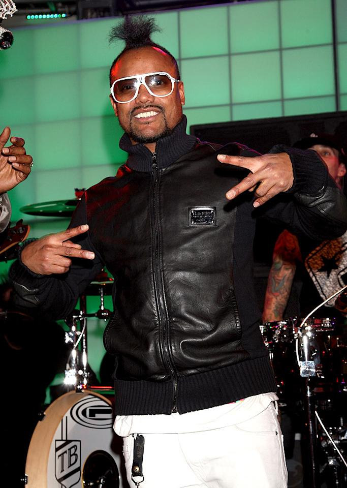 "Sporting an amusing topknot hairstyle, Black Eyed Peas musician apl.de.ap hit the stage to party with his boys. Michael Kovac/<a href=""http://www.filmmagic.com/"" target=""new"">FilmMagic.com</a> - December 8, 2009"