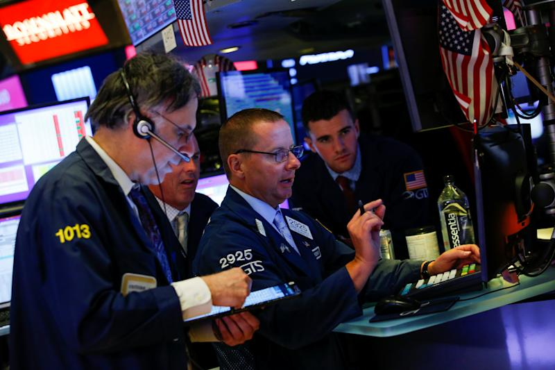 Traders work on the floor at the New York Stock Exchange (NYSE) in New York, U.S., August 14, 2019. REUTERS/Eduardo Munoz