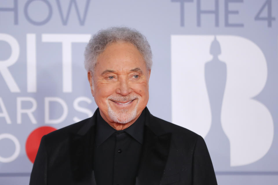 Sir Tom Jones has become the oldest male with a number one album in the UK charts. (Photo by TOLGA AKMEN/AFP via Getty Images)