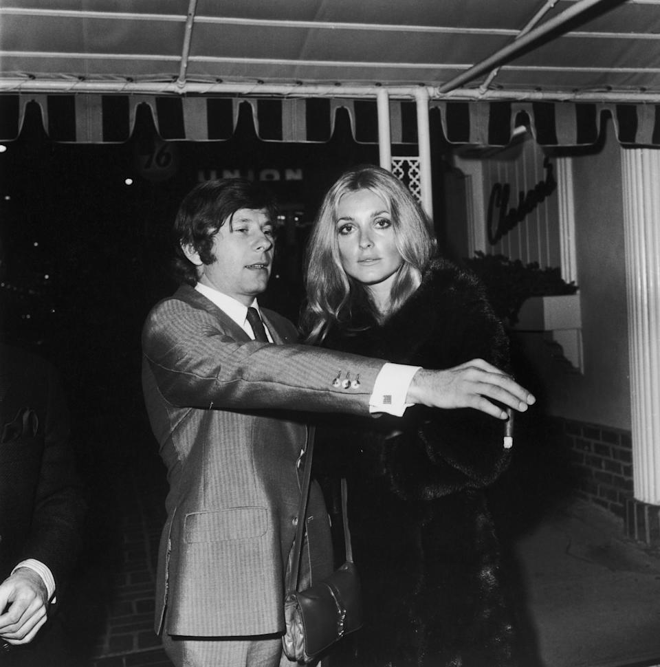 Polish director Roman Polanski and his wife, American actress Sharon Tate (1943 - 1969), outside the Daisy Club in Hollywood, California, April 1968. (Photo by Frank Edwards/Fotos International/Getty Images)