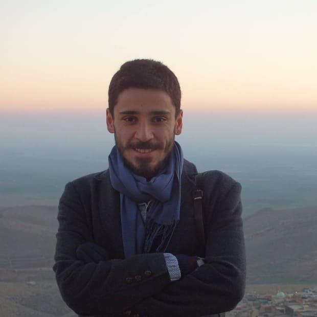Cihan Erdal is being accused of inciting violence in connection with two social media posts he made in 2014, when he was a youth member of the pro-Kurdish People's Democratic Party. (Ömer Ongun/Family handout - image credit)