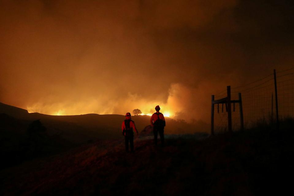 Two firefighters monitor the Kincade fire, near Geyserville, California, U.S. October 24, 2019. (Photo: Stephen Lam/Reuters)