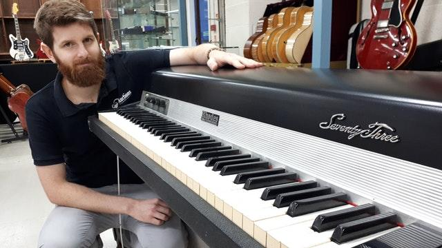 Auctioneer Luke Hobbs with the Fender Rhodes electric piano owned by former-10cc member Eric Stewart