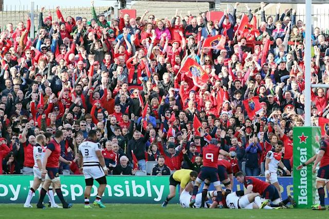Munster fans celebrate their team's first try during the European Champions Cup quarter-final match against Toulouse, at Thomond Park in Limerick, Ireland, on April 1, 2017 (AFP Photo/Paul Faith)