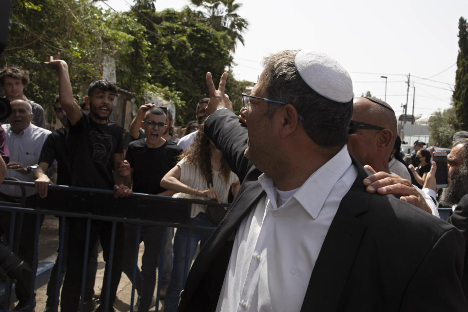 Israeli Knesset member Itamar Ben Gvir gives a victory sign as he argues with Palestinians during a visit to the Sheikh Jarrah neighborhood of East Jerusalem, Monday, May 10, 2021. (AP Photo/Sebastian Scheiner)