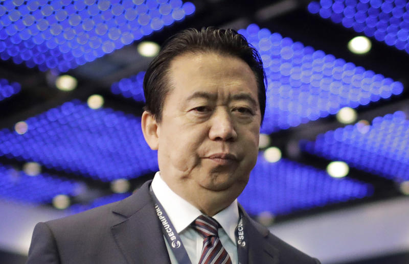 FILE - In this July 4, 2017, file photo, Interpol President, Meng Hongwei, walks toward the stage to deliver his opening address at the Interpol World Congress in Singapore. The wife of Meng Hongwei, the former Interpol president jailed in China for what she believes are political reasons, says France has granted asylum to her and their two young boys. (AP Photo/Wong Maye-E, File)