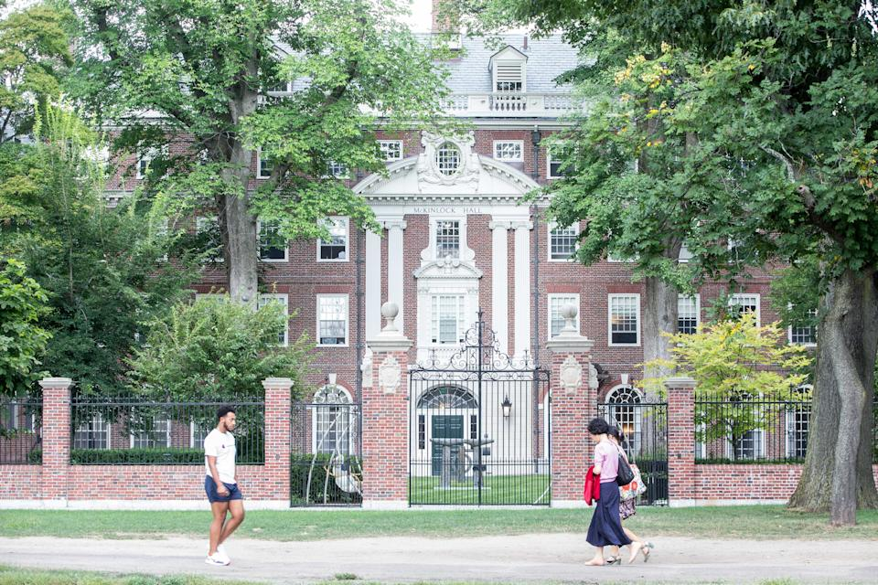 CAMBRIDGE, MA - AUGUST 30: Pedestrians walk past a Harvard University building on August 30, 2018 in Cambridge, Massachusetts. The U.S. Justice Department sided with Asian-Americans suing Harvard over admissions policy.  (Photo by Scott Eisen/Getty Images)