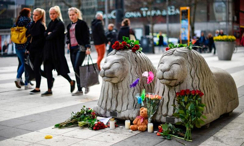 Flowers and candles at a makeshift memorial near the Stockholm attack site.