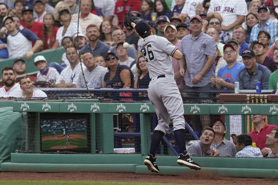 New York Yankees first baseman DJ LeMahieu can't make the play on a foul ball by Boston Red Sox's Xander Bogaerts during the first inning of a baseball game at Fenway Park, Thursday, July 22, 2021, in Boston. (AP Photo/Elise Amendola)