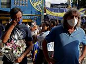 Fans of Argentinian football legend Diego Maradona pay homage outside La Bombonera stadium at La Boca neighborhood, in Buenos Aires on November 25, 2020, on the day of his death. (Photo by ALEJANDRO PAGNI / AFP) (Photo by ALEJANDRO PAGNI/AFP via Getty Images)
