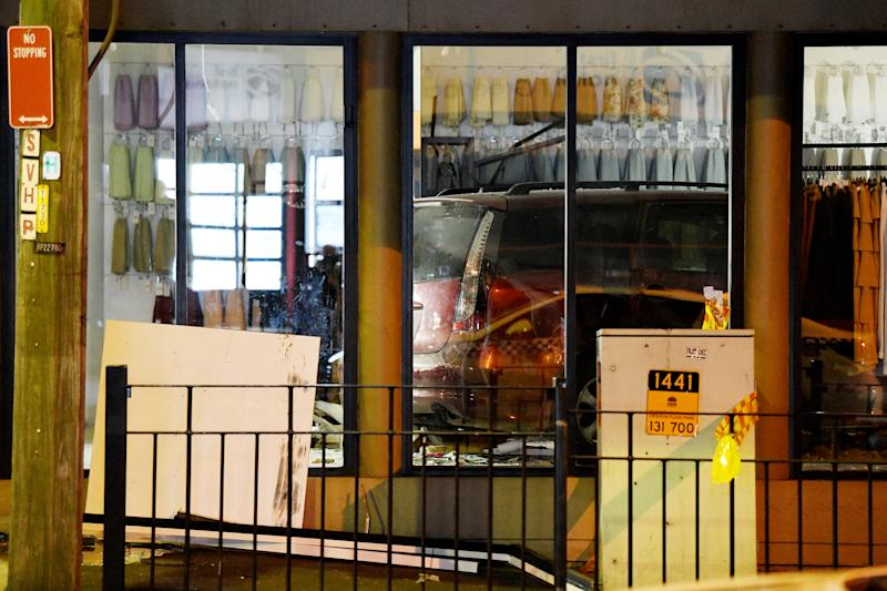 A car is seen in a shop after it crashed through the front windows in Greenacre in Sydney's west on Thursday. Source: AAP
