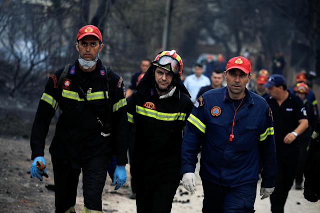 <p>Rescuers arrive at the area where bodies were found following a wildfire at the village of Mati, near Athens, Greece, July 24, 2018. (Photo: Alkis Konstantinidis/Reuters) </p>