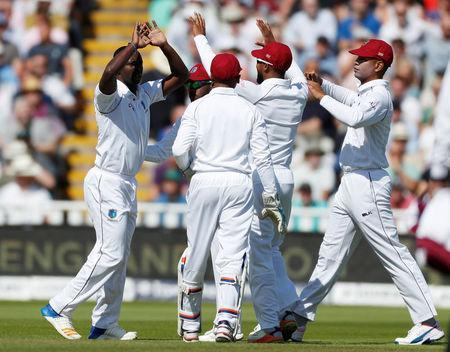 Cricket - England vs West Indies - First Test - Birmingham, Britain - August 17, 2017 West Indies' Kemar Roach (L) celebrates taking the wicket of England's Mark Stoneman Action Images via Reuters/Paul Childs