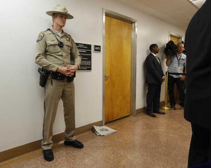 A California highway patrol officer stands outside the office of Sen. Leland Yee, D-San Francisco, at the state Capitol, Wednesday, March 26, 2014, in Sacramento, Calif. FBI spokesman Peter Lee said Yee was arrested Wednesday, he declined to discuss the charges, citing an ongoing investigation. (AP Photo/Rich Pedroncelli)