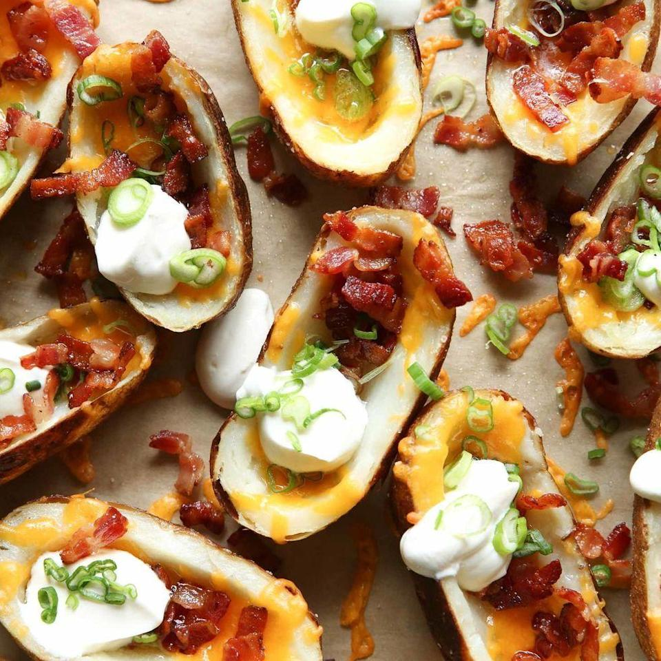 """<p>Loaded potato skins are kind of the perfect <a href=""""https://www.delish.com/uk/cooking/recipes/g30778888/party-food/"""" rel=""""nofollow noopener"""" target=""""_blank"""" data-ylk=""""slk:party food"""" class=""""link rapid-noclick-resp"""">party food</a>. They're inexpensive to make, they're full of flavour, and they're topped with ALL our favourite things. (We're talkin' bacon, sour cream, and lots of cheese.) We've got them in our party app rotation, and we think you should too!</p><p>Get the <a href=""""https://www.delish.com/uk/cooking/recipes/a31109706/loaded-potato-skins-recipe/"""" rel=""""nofollow noopener"""" target=""""_blank"""" data-ylk=""""slk:Loaded Potato Skins"""" class=""""link rapid-noclick-resp"""">Loaded Potato Skins</a> recipe.</p>"""
