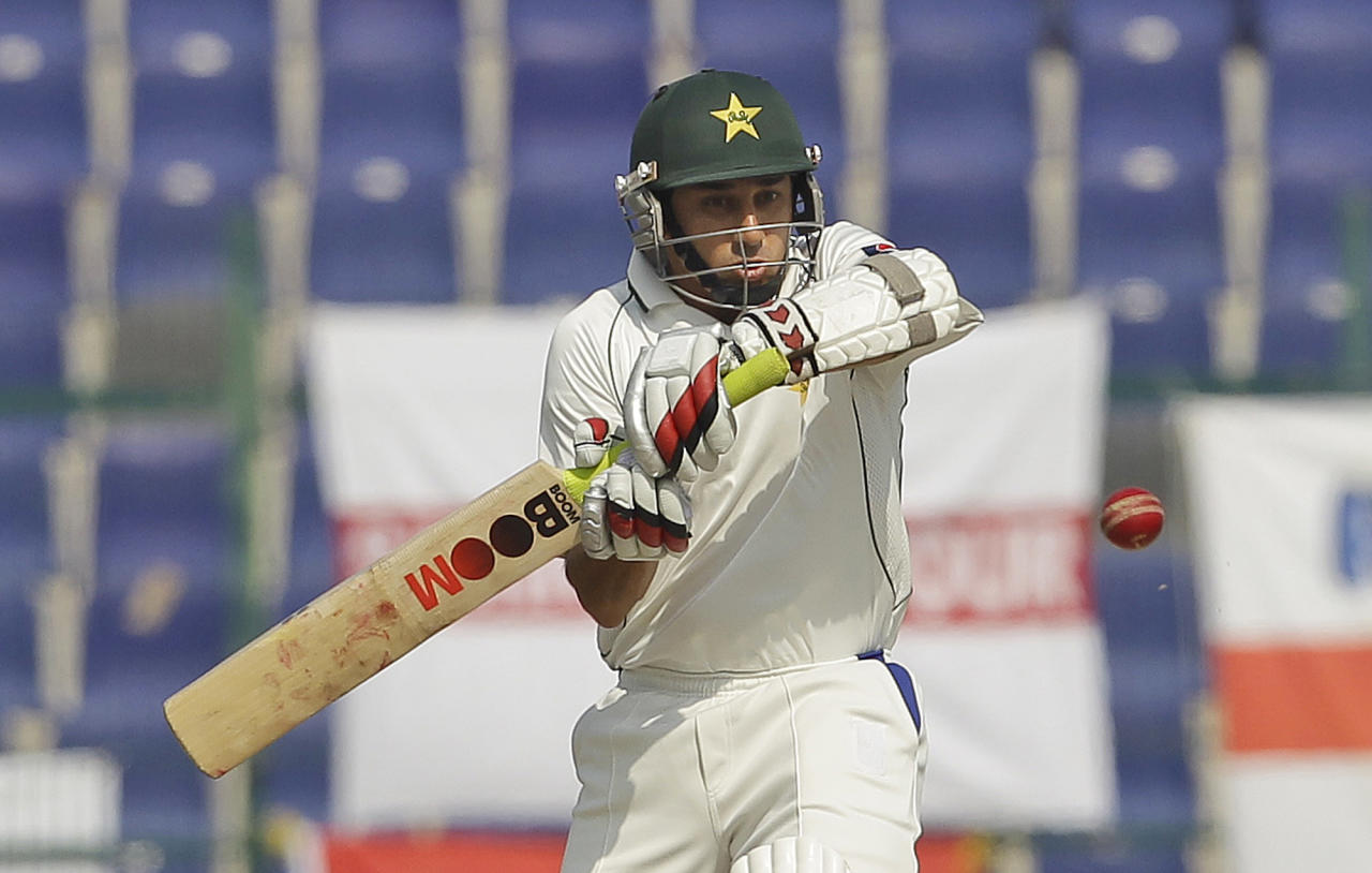 Pakistan's Saeed Ajmal hits the ball during the fourth day of the second cricket test match of a three match series between England and Pakistan at Zayed Cricket Stadium in Abu Dhabi, United Arab Emirates, Saturday, Jan. 28, 2012. (AP Photo/Hassan Ammar)