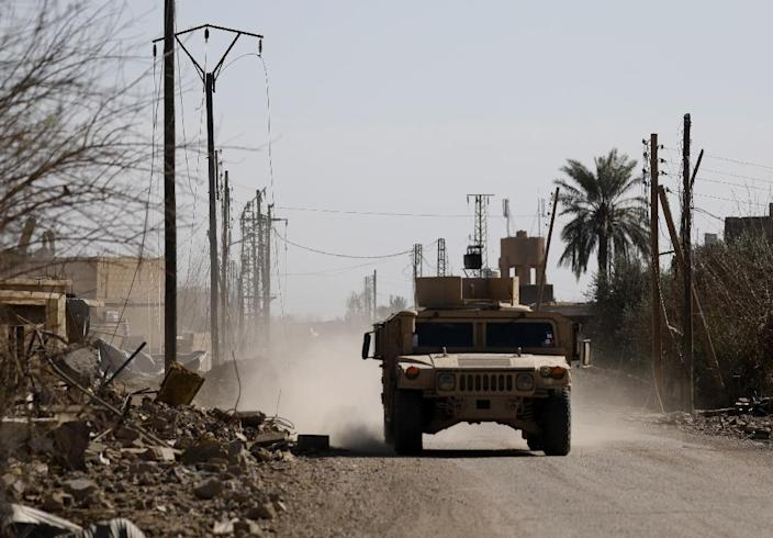 A Syrian Democratic Forces armored vehicle patrols near the village of Baghouz in the Syrian province of Deir Ezzor on February 2 (AFP Photo/DELIL SOULEIMAN)