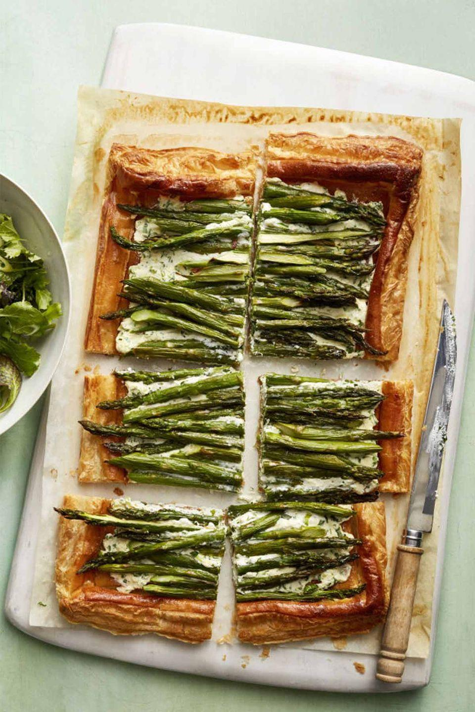 """<p>Topped with creamy ricotta and roasted asparagus, this crispy puff pastry tart can be the main course or served just before mom's favorite entrée at her Mother's Day dinner.</p><p><em><a href=""""https://www.womansday.com/food-recipes/food-drinks/recipes/a58519/asparagus-ricotta-tart-recipe/"""" rel=""""nofollow noopener"""" target=""""_blank"""" data-ylk=""""slk:Get the recipe for Asparagus and Ricotta Tart."""" class=""""link rapid-noclick-resp"""">Get the recipe for Asparagus and Ricotta Tart.</a> </em><br></p>"""