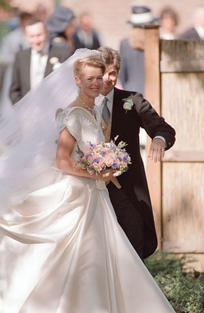 <p>For her 1992 wedding to Timothy Taylor, Lady Helen of Windsor had British designer Catherine Walker create a custom ivory silk gown with a wide arching neckline that turned heads. </p>
