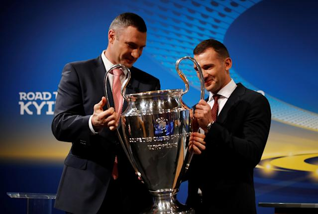 Soccer Football - Champions League Semi-Final Draw - Nyon, Switzerland - April 13, 2018 Mayor of Kiev and former boxer Vitali Klitschko and Andriy Shevchenko pose for photos with the Champions League trophy REUTERS/Stefan Wermuth