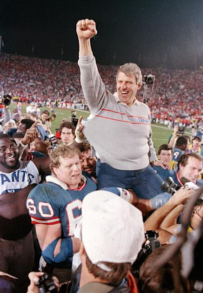 FILE - In this Jan. 25, 1987, file photo, New York Giants coach Bill Parcells is carried off the field after the Giants defeated the Denver Broncos 39-20 in SuperBowl XXI NFL football game in Pasadena, Calif. Parcells was selected to the Pro Football Hall of Fame on Saturday, Feb. 2, 2013. (AP Photo/Eric Risberg, File)