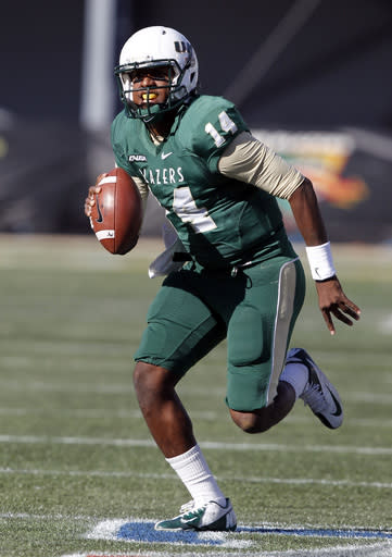 UAB quarterback Jonathan Perry (14) scrambles for a first down during the second half of an NCAA college football game against Middle Tennessee State on Saturday, Nov. 2, 2013, in Birmingham, Ala. (AP Photo/Butch Dill)