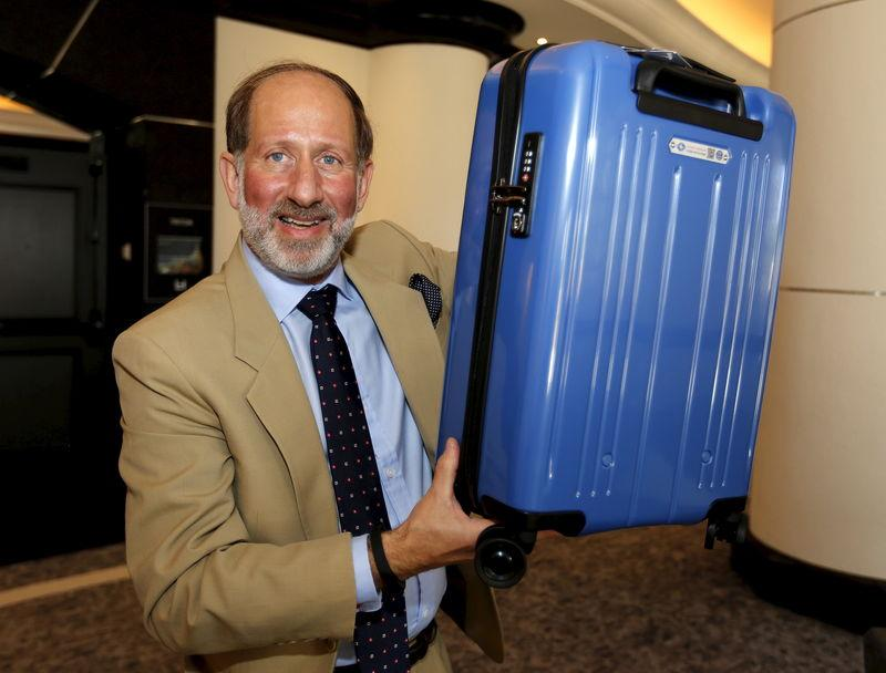 Windmuller, a vice president of the International Air Transport Association (IATA), holds a carry-on bag which conforms to a new minimum size announced by the group, at the group's annual meeting in Miami Beach
