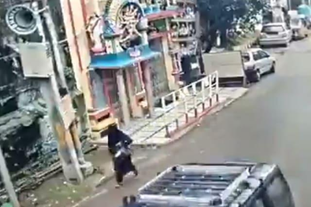 That was close! Woman narrowly escapes collapsing building