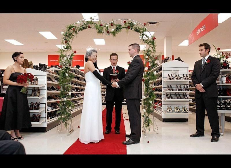 """It's a woman's two favorite things in life: commitment and shoes. Lisa Satayut and Drew Ellis wed at the T.J. Maxx store in Mount Pleasant, Mich., on Aug. 3, 2010. The couple tied the knot in the shoe isle -- Satayut's self-professed """"happy place"""" at her favorite discount retailer."""