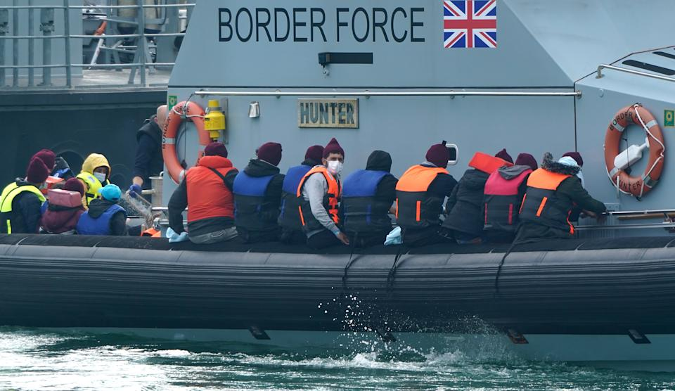 A group of people thought to be migrants are brought in to Dover, Kent, onboard a Border Force vessel, following a small boat incident in the Channel. Picture date: Monday July 26, 2021. (Photo by Gareth Fuller/PA Images via Getty Images)