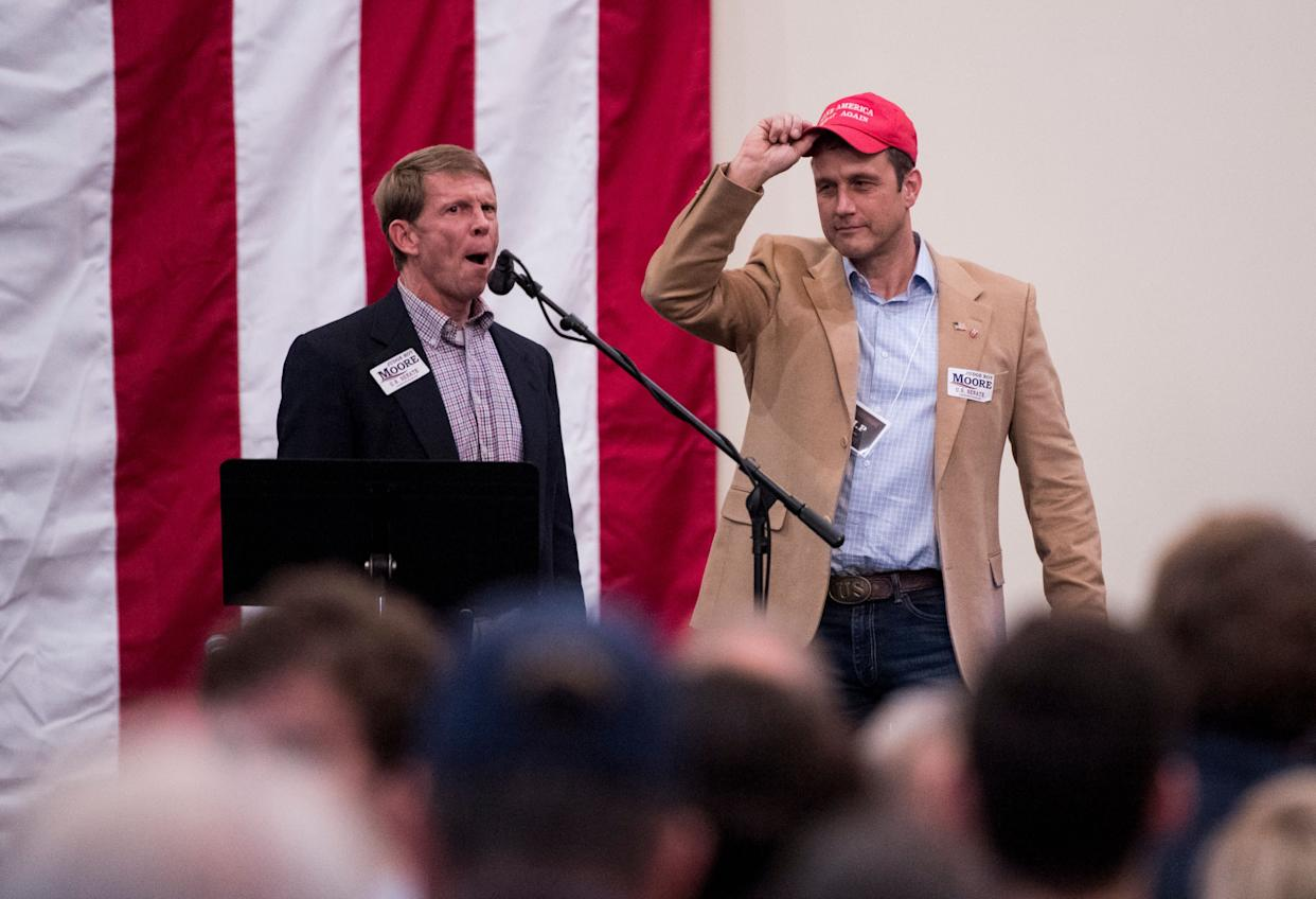 "Paul Nehlen, right, is introduced at a ""Drain the Swamp"" campaign rally for Alabama Republican Senate candidate Roy Moore last December. Moore lost the special election that month; Nehlen lost his bid for a House seat in Wisconsin on Tuesday. (Photo: Bill Clark via Getty Images)"