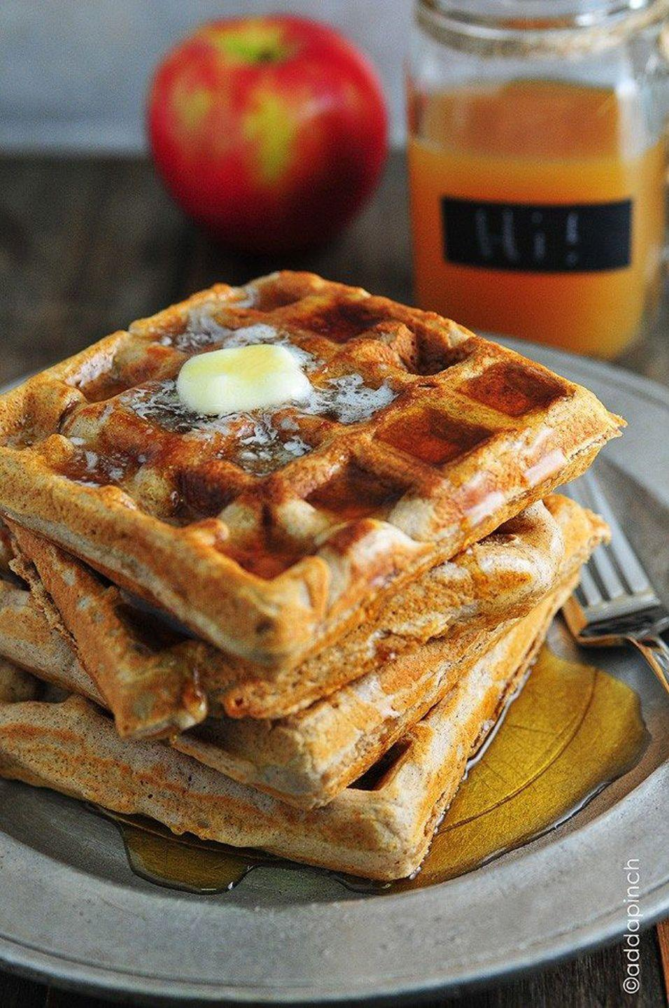"<p>Put a spin on apple cider by adding it to warm waffles and dousing them with maple syrup.</p><p><strong>Get the recipe at <a href=""https://addapinch.com/waffle-recipe-apple-cider-waffles/"" rel=""nofollow noopener"" target=""_blank"" data-ylk=""slk:Add a Pinch"" class=""link rapid-noclick-resp"">Add a Pinch</a>.</strong></p>"
