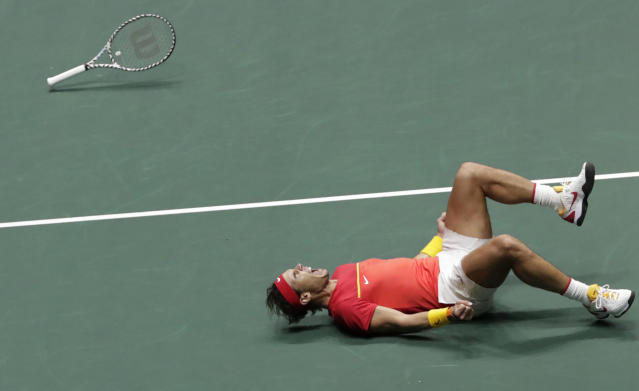 Spain's Rafael Nadal celebrates after winning their Davis Cup semifinal doubles match with his partner Feliciano Lopez against Great Britain's Jamie Murray and Neal Skupski in Madrid, Spain, early Sunday, Nov. 24, 2019. (AP Photo/Bernat Armangue)
