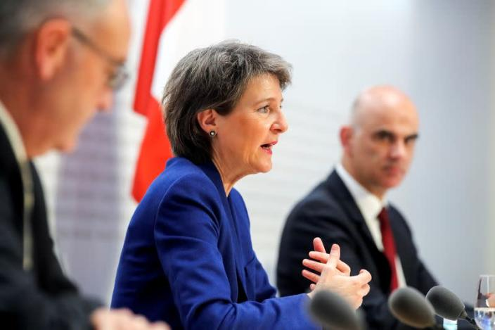 Swiss Interior Minister Alain Berset, Swiss President Simonetta Sommaruga and Swiss Economic Minister Guy Parmelin hold a news conference, in Bern