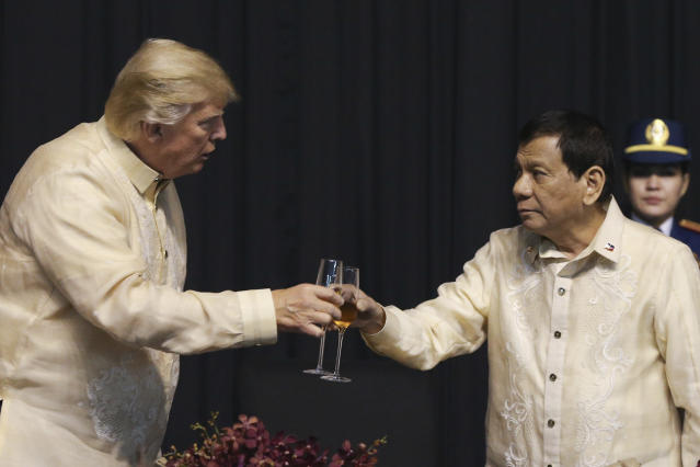 <p>U.S. President Donald Trump toasts with Philippines President Rodrigo Duterte during the gala dinner marking ASEAN's 50th anniversary in Manila, Philippines, Nov. 12, 2017. (Photo: Athit Perawongmetha/AP) </p>